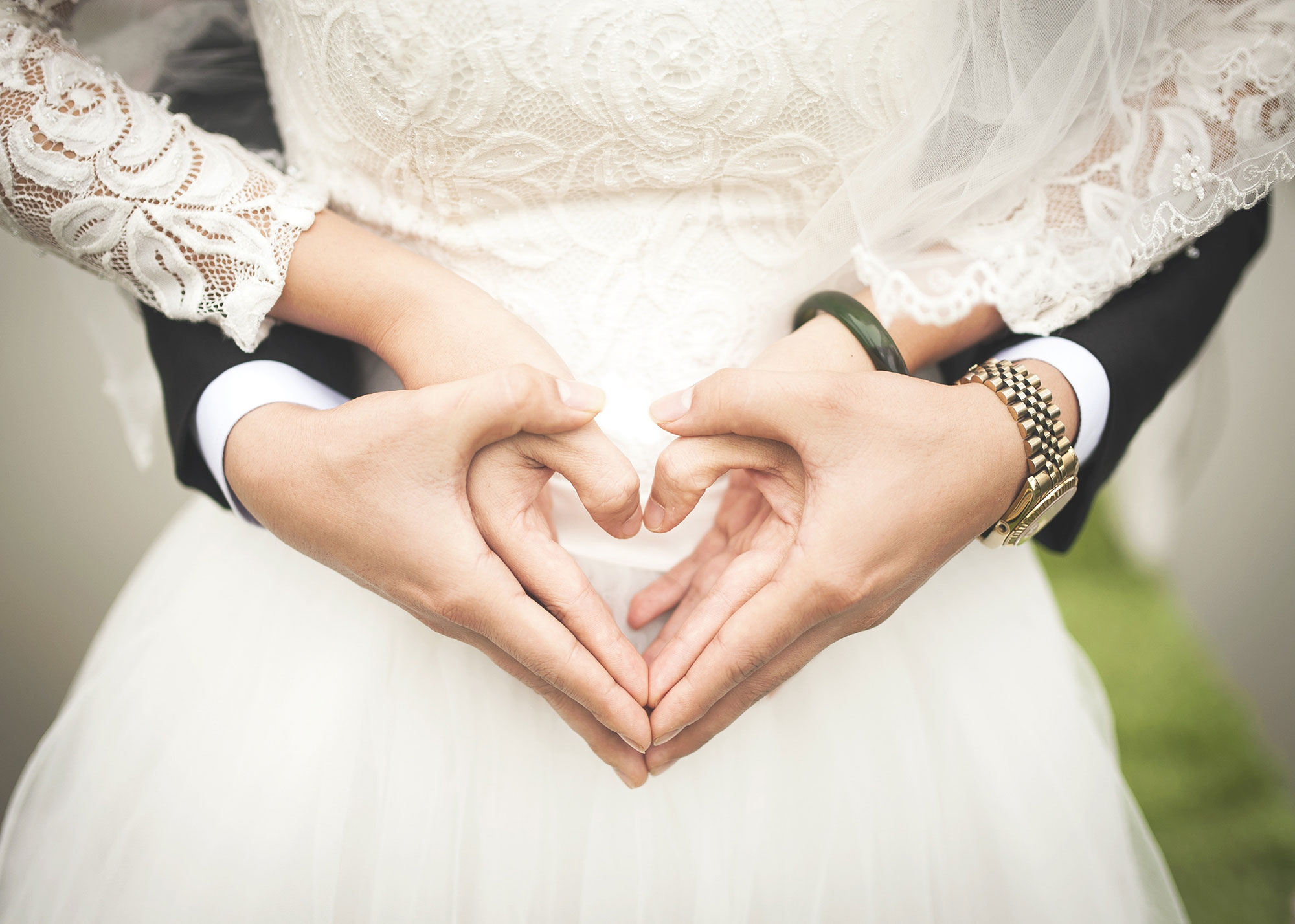 Couple forming a heart with their hands